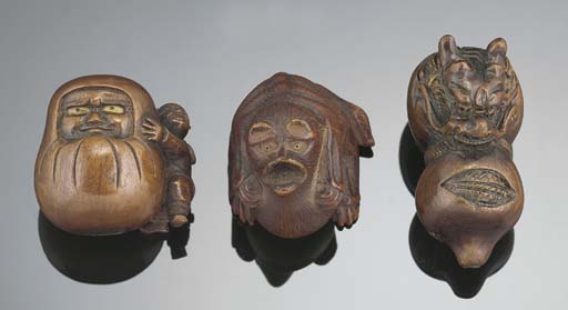 A Japanese wood netsuke of Dar