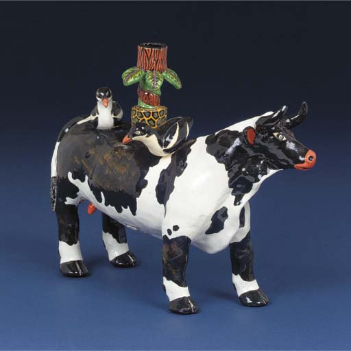 A Nguni cow and plover candles