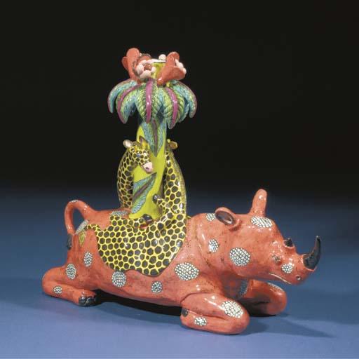 A rhinoceros and giraffe candl