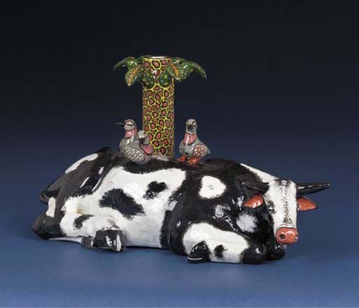 A Nguni cow and pidgeon candle