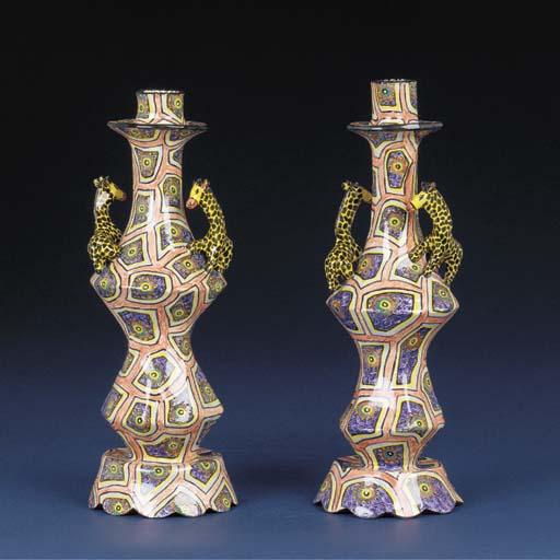 A pair of giraffe candlesticks