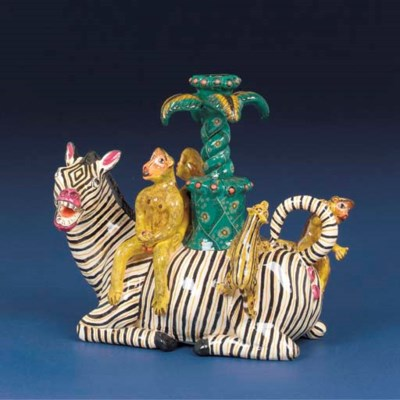 A monkey and zebra candlestick