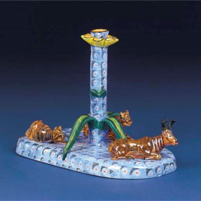 A tiger and buck candlestick