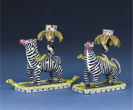 A pair of zebra and snake cand