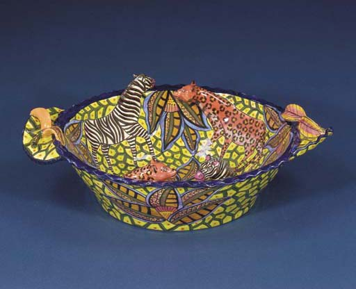A zebra and leopard bowl