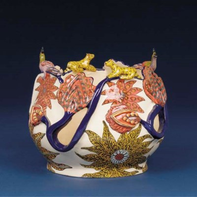 A peacock and leopard planter
