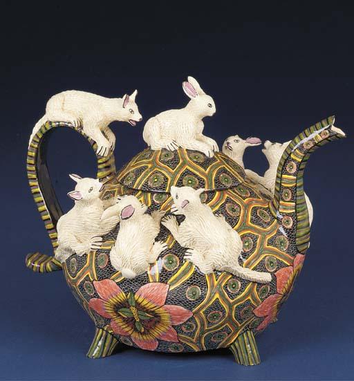 A rabbit tea pot and cover