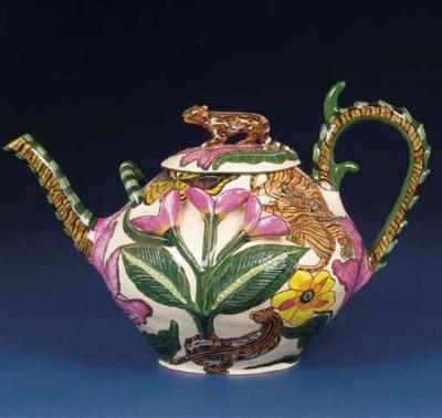 A tiger tea pot and cover