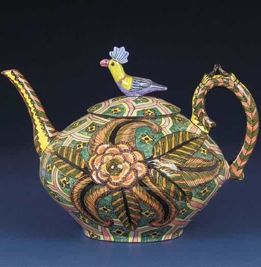 A bird tea pot and cover