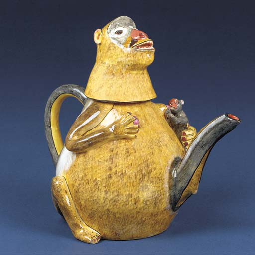 A monkey tea pot and cover