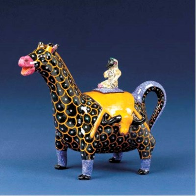 A giraffe tea pot and cover