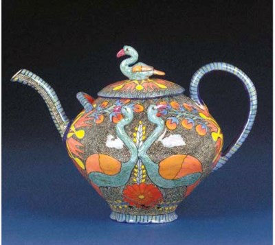 A heron bird tea pot and cover