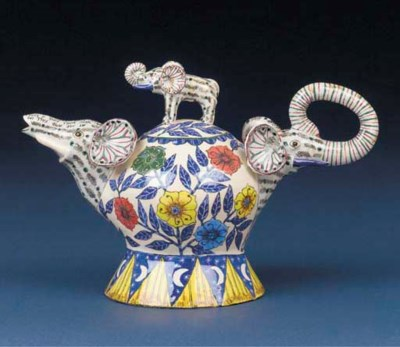 An elephant tea pot and cover