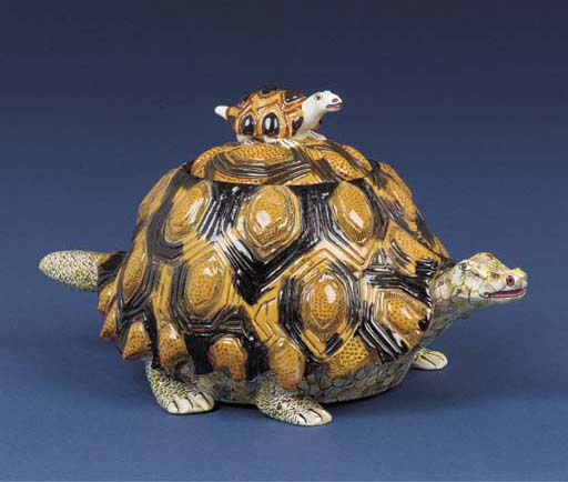 A tortoise tureen and cover