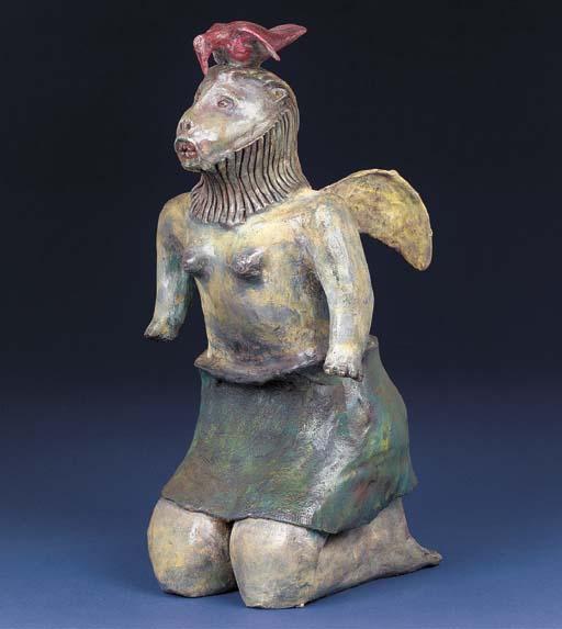 A Kneeling lioness sculpture