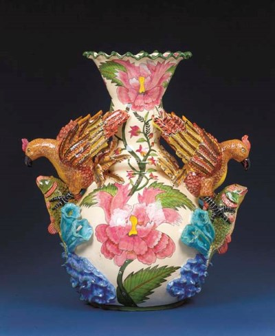 A bird and fish vase