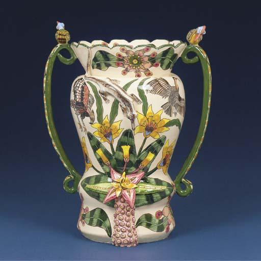 A lizard and bird vase