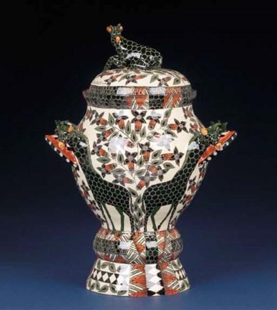 A giraffe urn and cover