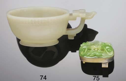 A Chinese celadon jade handled