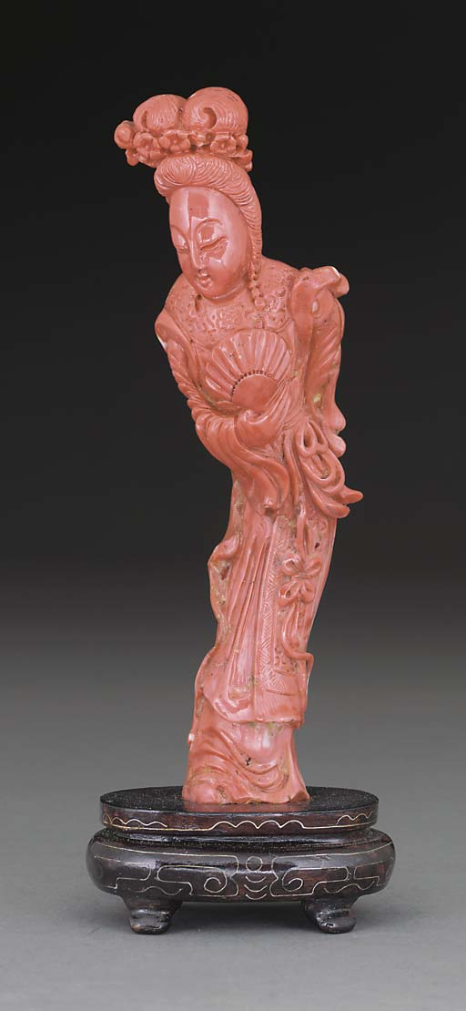 A Chinese coral carved model o