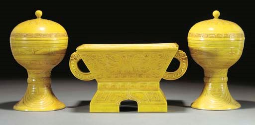 A pair of yellow glazed altar