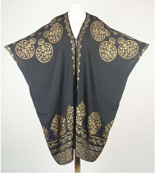 A tunic of black silk crêpe, s