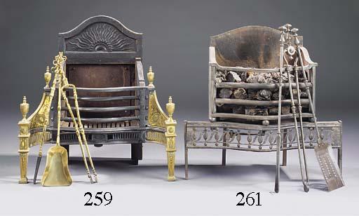 A steel and brass firegrate