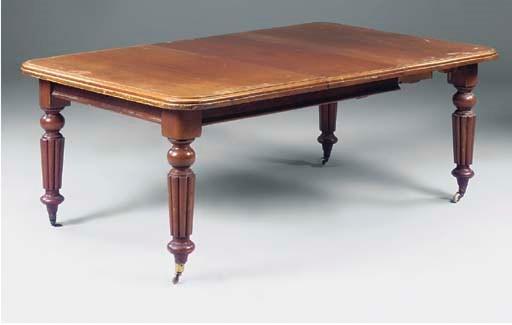 A Victorian mahogany dining ta