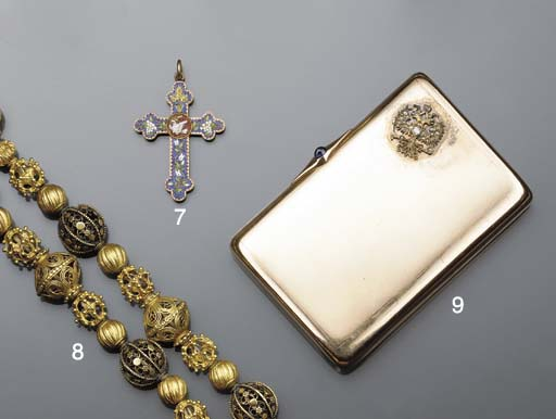 A gold cigarette case by Faber