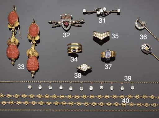 A diamond five stone brooch