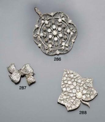 A diamond bow brooch by Garrar