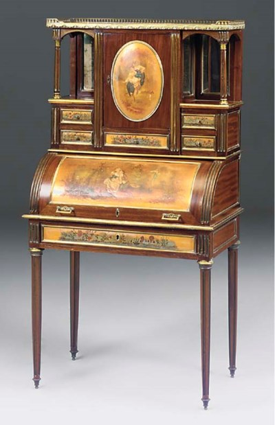 A gilt metal mounted mahogany