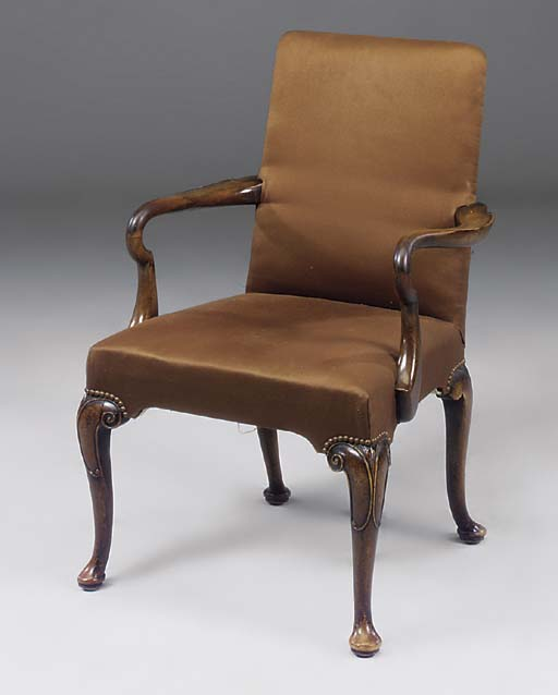 A WALNUT AND UPHOLSTERED ARMCH