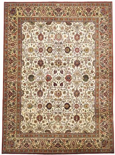 A fine Amir-Khis Tabriz carpet