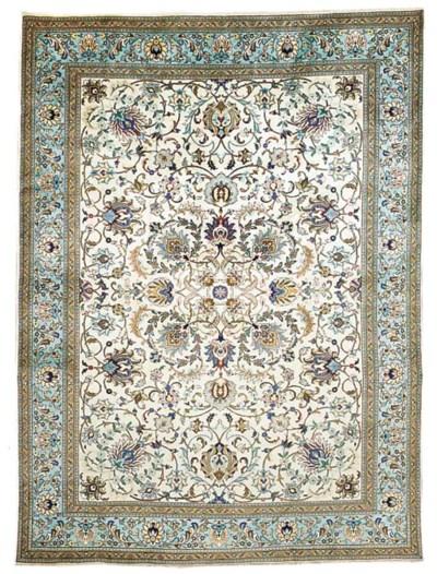 A fine Tabriz carpet, North-We