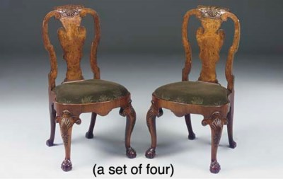 A SET OF FOUR WALNUT AND BURR