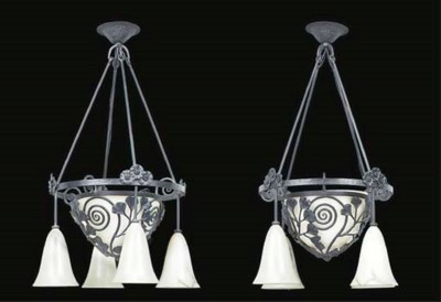A PAIR OF WROUGHT IRON AND ALA