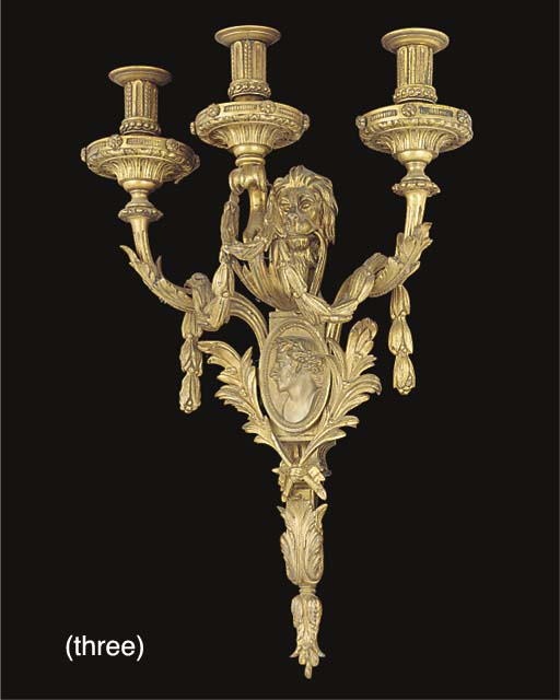 A SET OF THREE GILT BRONZE THR