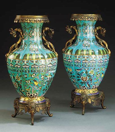 A PAIR OF BRONZE AND ENAMEL TA