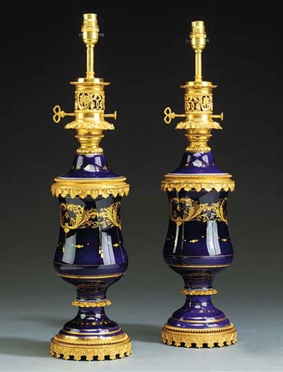 A PAIR OF GILT BRONZE AND BLUE