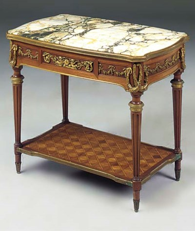 A FRENCH MAHOGANY ORMOLU MOUNT