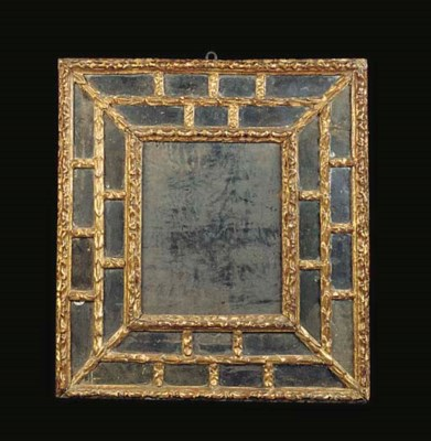 A SPANISH GILTWOOD MIRROR Late