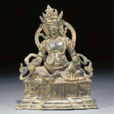 A Nepalese bronze seated deity