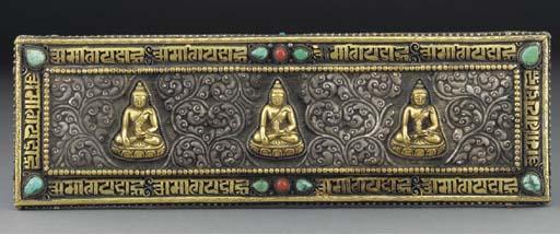 A pair of Tibetan gilt and sil