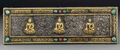 A pair of Tibetan gilt and sil