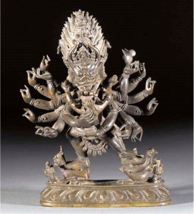 A Tibetan bronze model of Yama