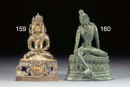 A Tibetan bronze figure of a b