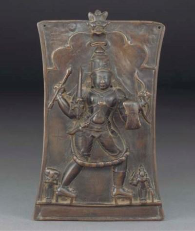 An Indian bronze repousse plaq