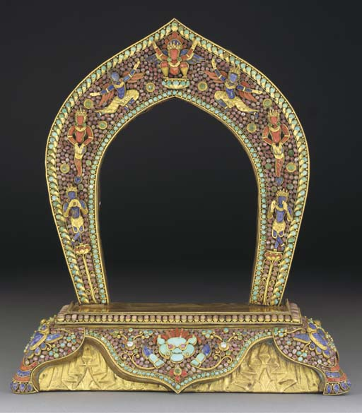 A Nepalese encrusted gilt-meta