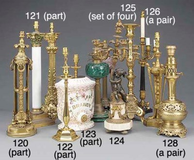 A set of four brass candlestic